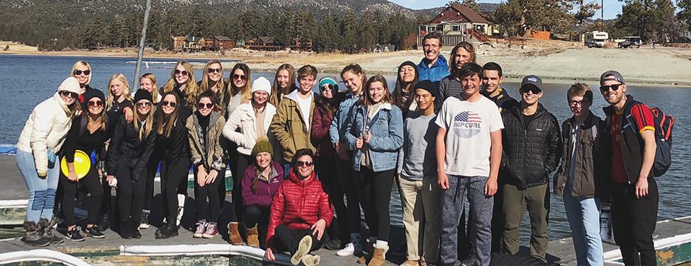 High School Ministry on docks during wilderness trip