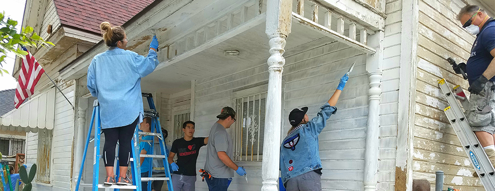 Youth group fixes up community home of community member