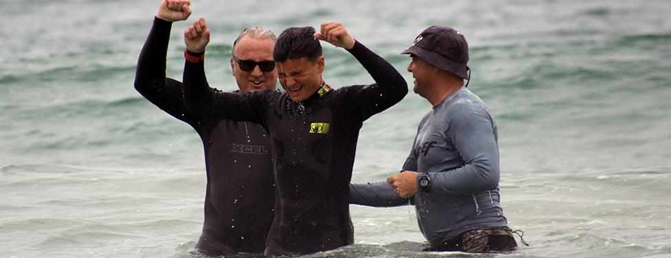 Teen celebrates after his baptism in ocean