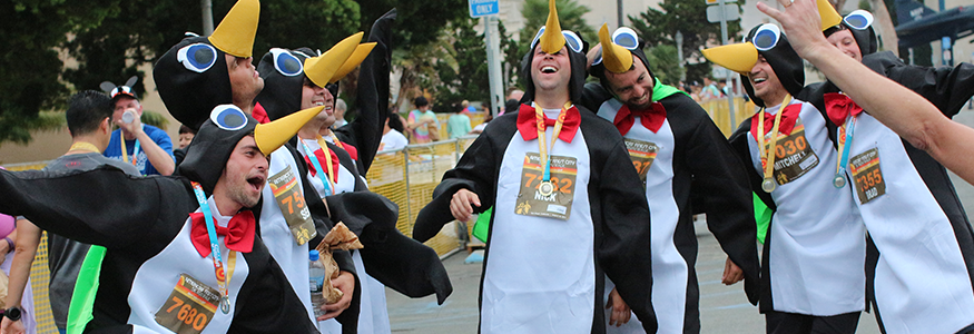 group of young men dressed as penguins for a race