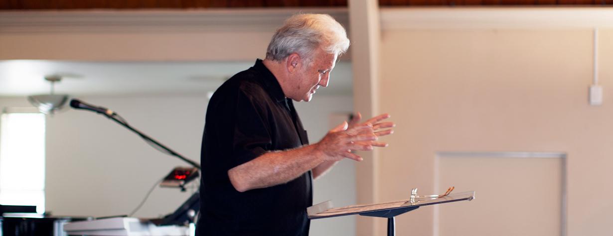 Senior pastor preaching a message