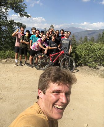 High Schoolers pose for a selfie with the group while at summer camp