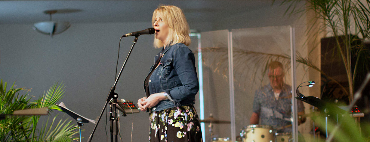 Singer leads the congregation in Sunday morning worship