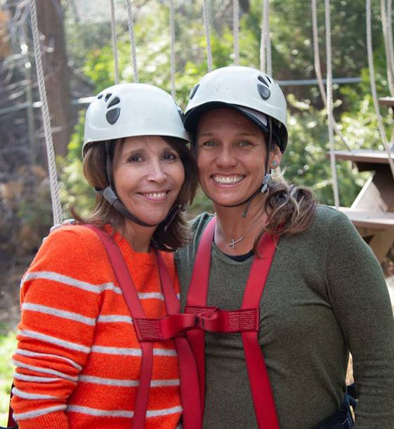 Women preparing to zipline