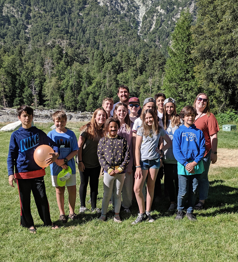 Youth and leaders pose for a photo at summer camp